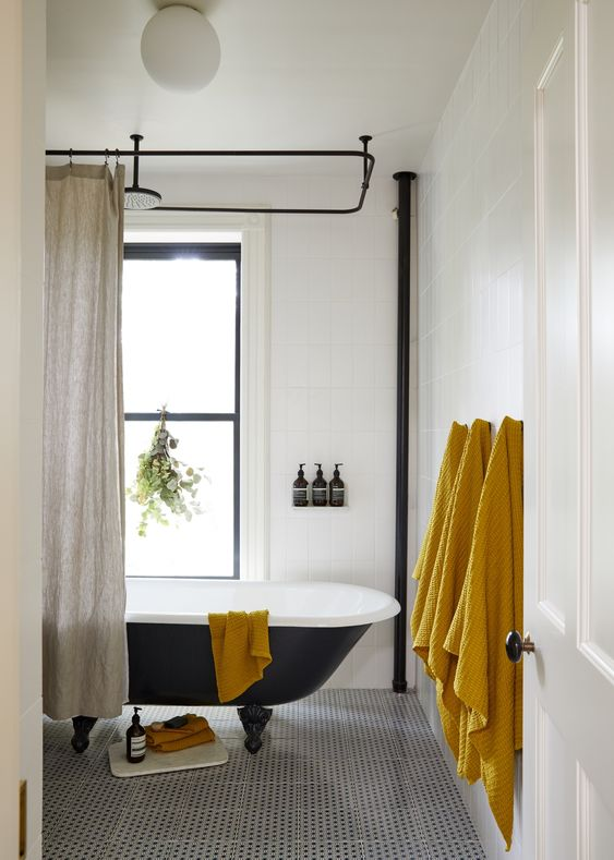 a set of mustard towels is a budget-friendly and easy way to bring a fall feel to your bathroom