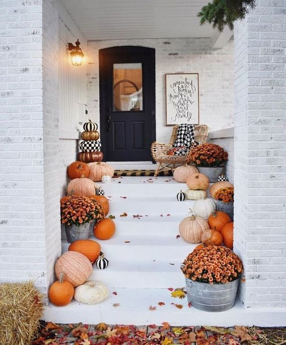 put natural pumpkins and fall blooms that you've grown on the steps indoors or outdoors