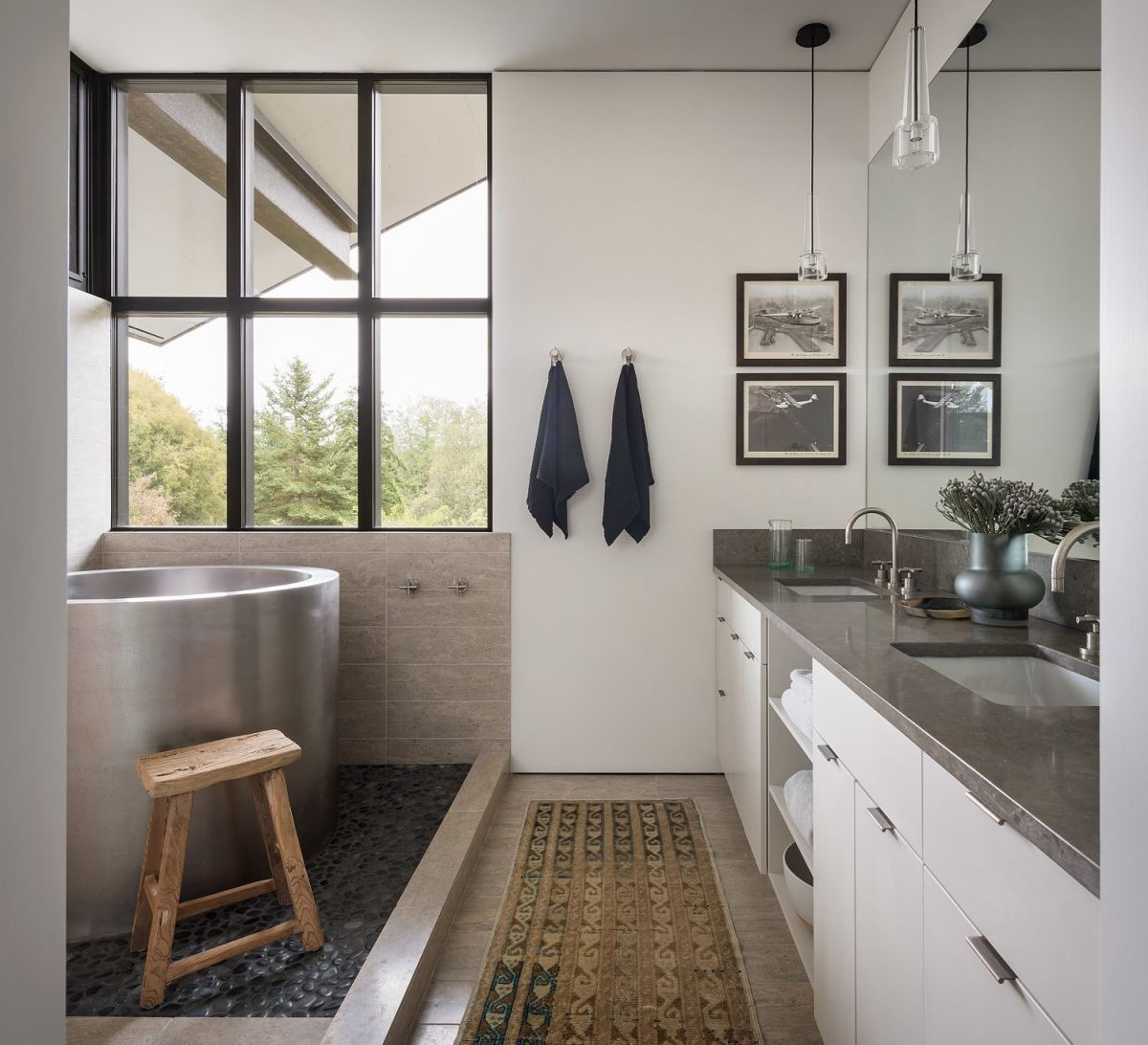 A soak tub is placed next to the window to enjoy the views