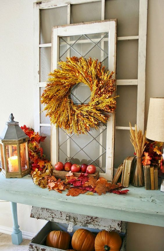 all-natural and rustic fall decor done with fall leaves, wheat, a wheat wreath, apples and pumpkins is just amazing