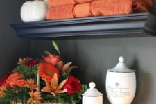 11 orange towels and a bright fall bloom arrangement in a basket will make your bathroom feel like fall