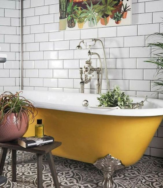 a yellow clawfoot bathtub is a cool colorful accent in fall style, it's a great idea for embracing the season