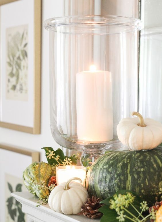 decorate your mantel with natural pumpkins, pinecones, greenery and gourds and add candles here and there