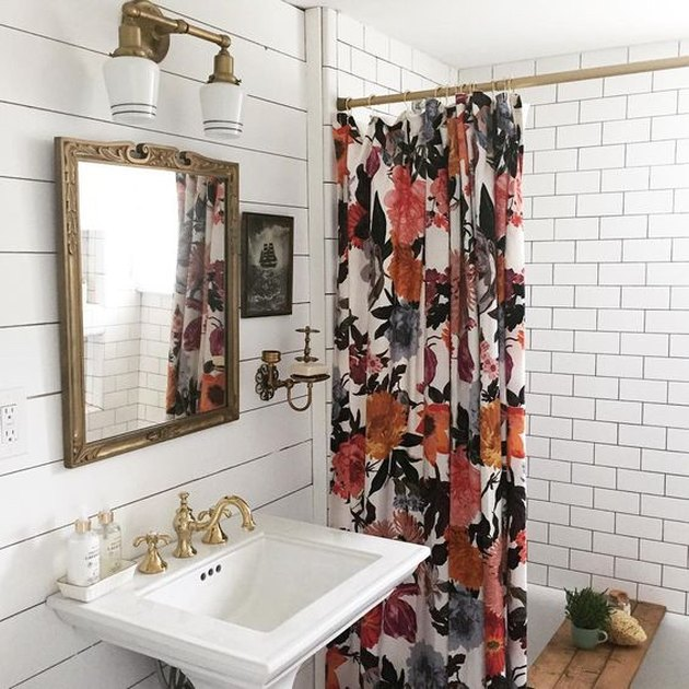 a floral shower curtain in bold fall blooms is a cool and easy accent to feel like fall