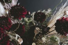 13 a super elegant Halloween centerpiece of a silver bowl and moody florals plus white dried herbs and greenery
