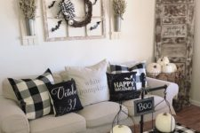 13 simple coffee table styling with scales with white pumpkins and a sign plus a checked table runner for a farmhouse space