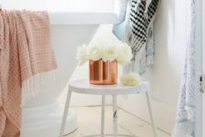 14 a copper pot with white roses and a copper towel are easy details to bring a fall feel to the space