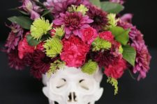 15 a skull with a bold flroal arrangement in pink, red and green plus some leaves is a timeless idea
