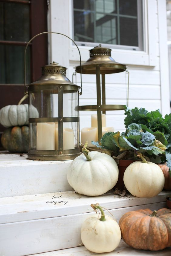 pumpkins, green leaves, candle lanterns are all you need for decorating your porch for the fall