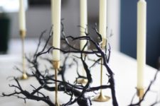 17 a black branch plus some tall candles in gold candleholders is a very elegant and chic option