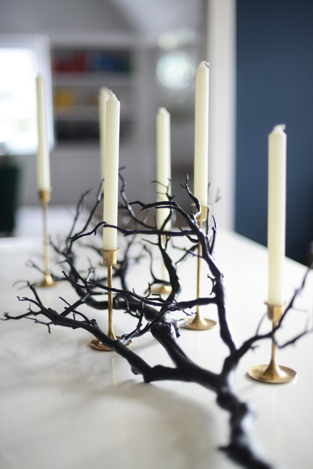 a black branch plus some tall candles in gold candleholders is a very elegant and chic option