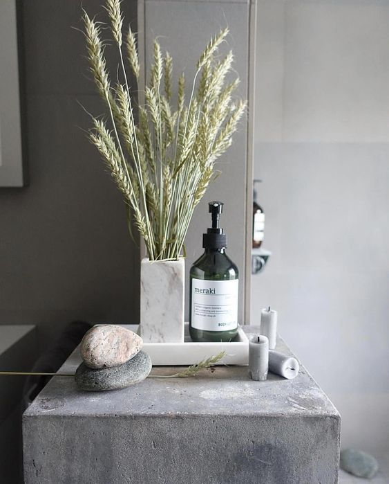 a wheat arrangement, some candles and pebbles will make your bathroom feel and look like a fall spa