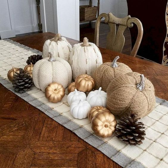 faux pumpkins of fabric, paper and plastic plus pinecones will give you a cool fall centerpiece