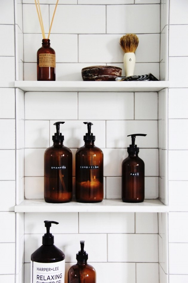 elegant and similar amber bottles for bathroom stuff is a cool idea to add color and elegance