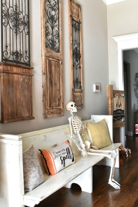 put a skeleton on the bench and some Halloween-inspired pillows, and you have a Halloween entryway