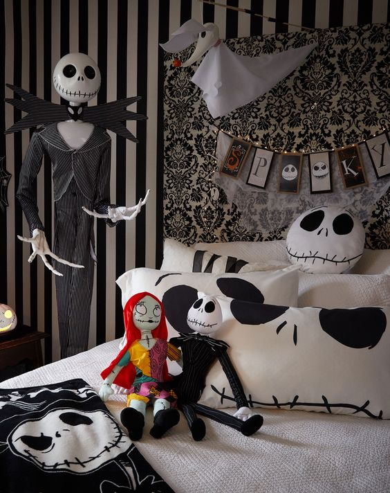 a black and white Halloween bedroom in Jack Skellington style, with dolls, a bunting, bedding and a Ghost dog
