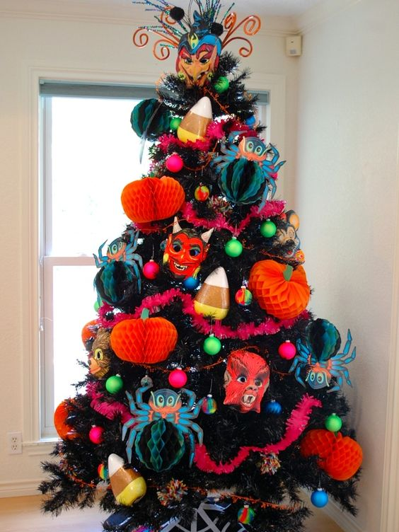 a bold and spooky Halloween tree with bright paper decorations, garlands and scary masks plus a creative topper