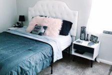 a glam Halloween bedroom with pretty photos, a coffin silhouette, a coffin and a skeleton rug and black and pink pillows