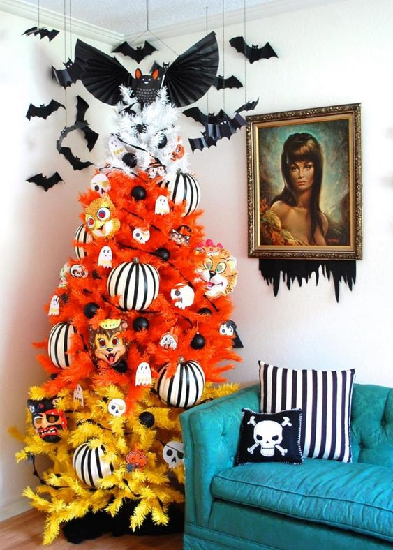 a gradient orange, yellow and white Halloween tree decorated with ghosts, striped ornaments, masks and bats
