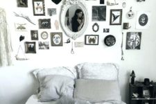 a monochromatic Halloween bedroom with a statement gallery wall that brigns that Halloween feel here