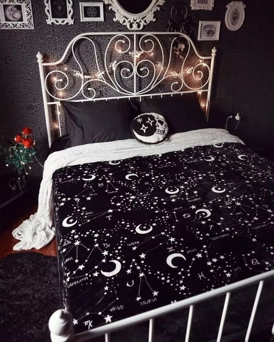 a moody bedroom spruce up with lights, celestial bedding, a skull moon pillow and some red roses for Halloween