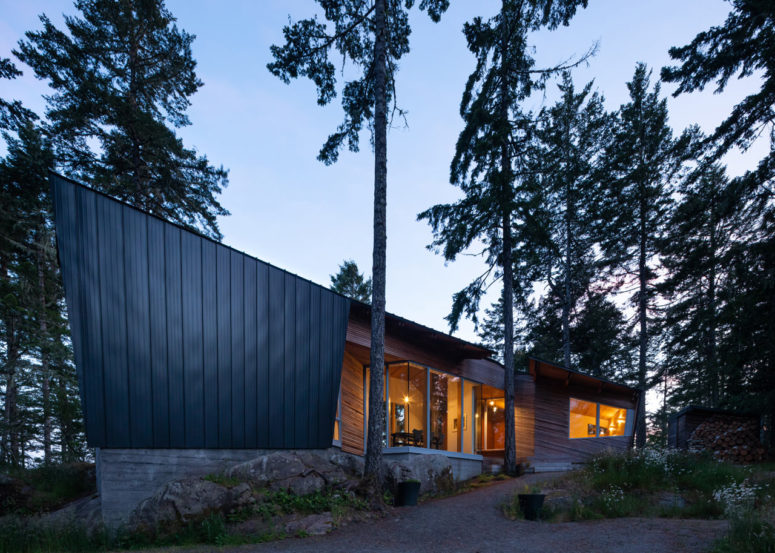This contemporary geometric home is built in the middle of the forest and features cool views and minimalist interiors