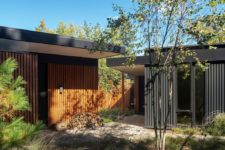 02 The house is clad with natural local wood in slabs to give it a contemporary and fresh look