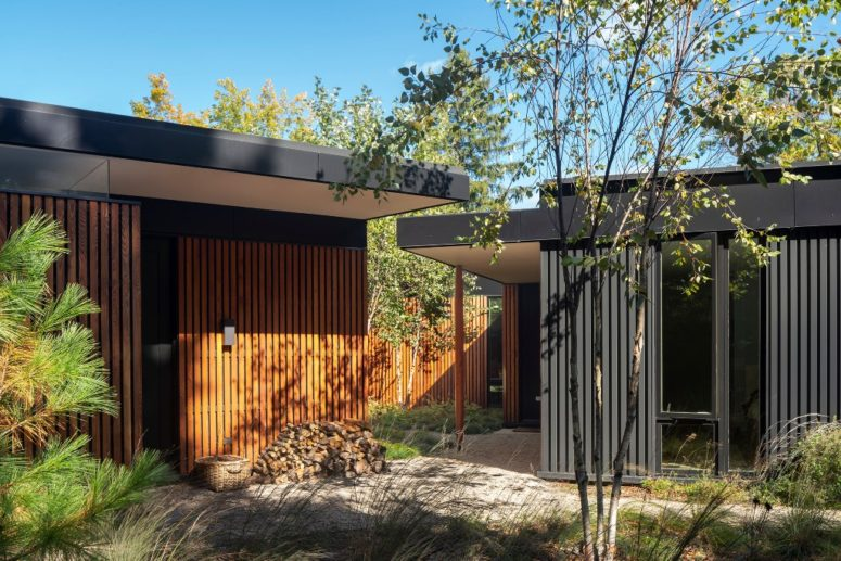 The house is clad with natural local wood in slabs to give it a contemporary and fresh look
