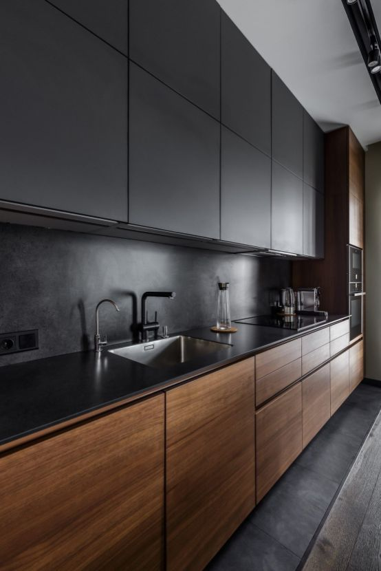 a minimalist black kitchen with sleek wooden lower cabinets that are a stylish option to spruce up the space