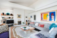 02 this basically neutral living room was spruced up with bright artworks, rugs, pillows for a bold and chic look