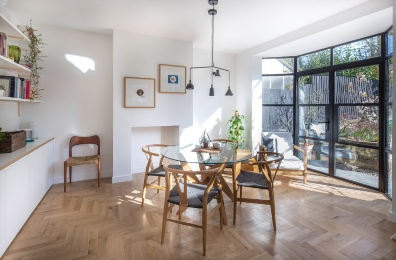The kitchen and dining space are also filled with light due to a glazed wall, there's stylish furniture and chic lamps