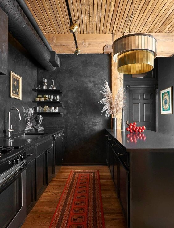 a creative vintage inspired kitchen in black with a light colored wooden ceiling and rich colored woodne floor to warm up the space