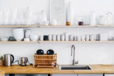 03 thin open minimalist shelves over the countertops that take the whole wall for maximal storage