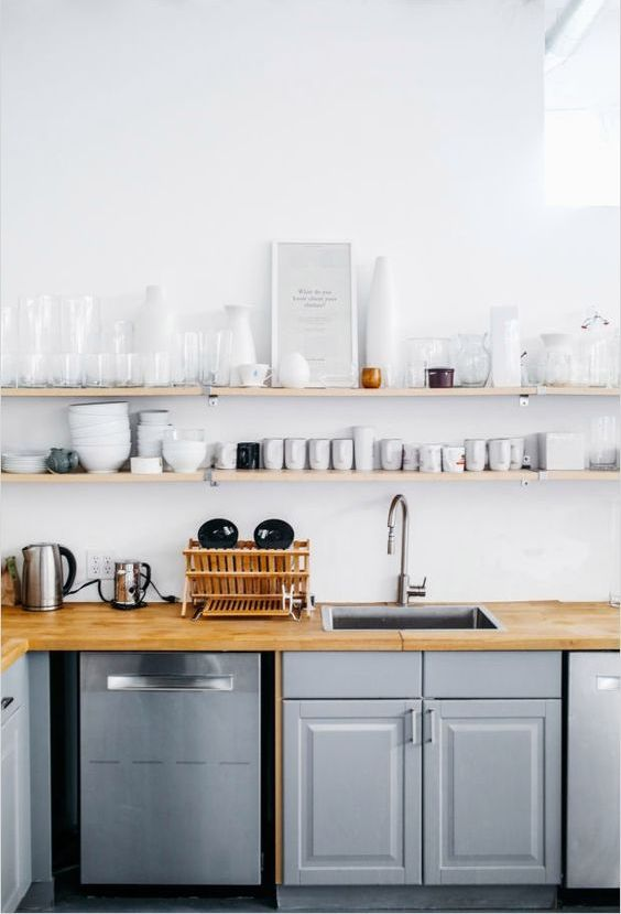 thin open minimalist shelves over the countertops that take the whole wall for maximal storage