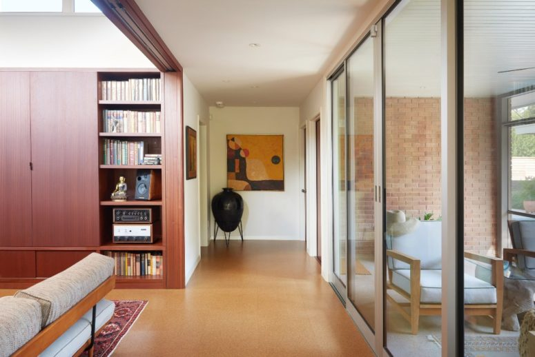 The architects used a modest color palette and humble and simpel materials to retain the original looks