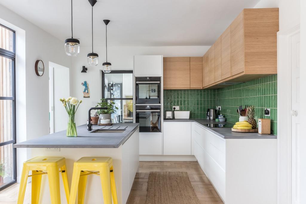 a modern kitchen island with a concrete countertop