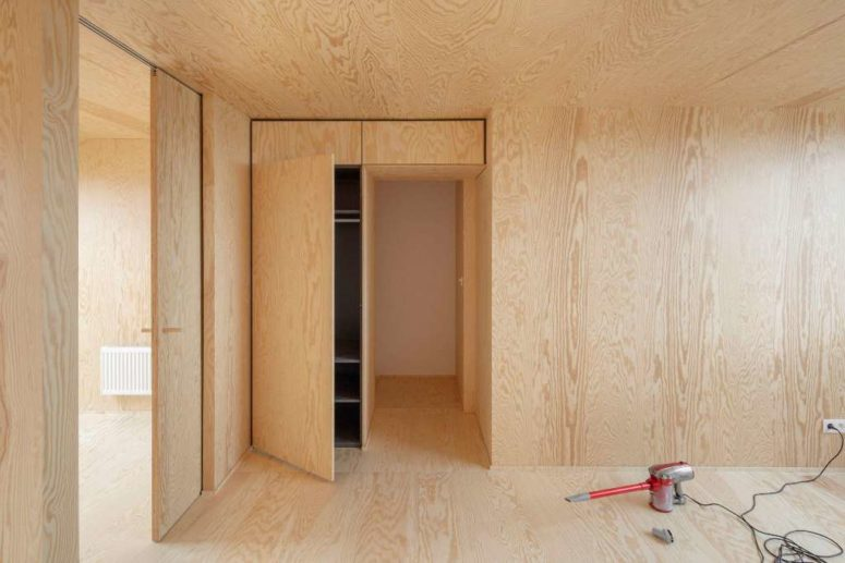The other spaces are done with light-colored plywood, there's plenty of storage space