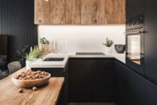 04 a black kitchen refresh with a white backsplash and wooden uppers plus a wooden countertop for a cozier feel