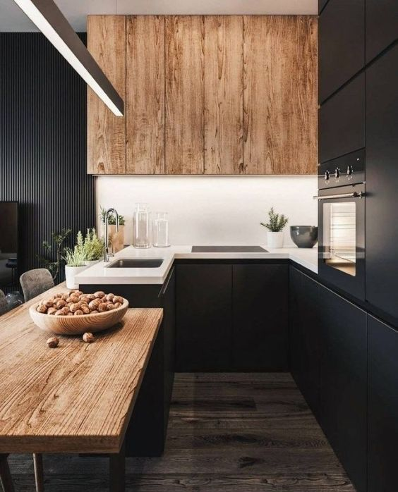 a black kitchen refresh with a white backsplash and wooden uppers plus a wooden countertop for a cozier feel