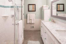 04 a very neutral and peaceful bathroom is refreshed with turquoise and aqua accents for a chic and calming feel