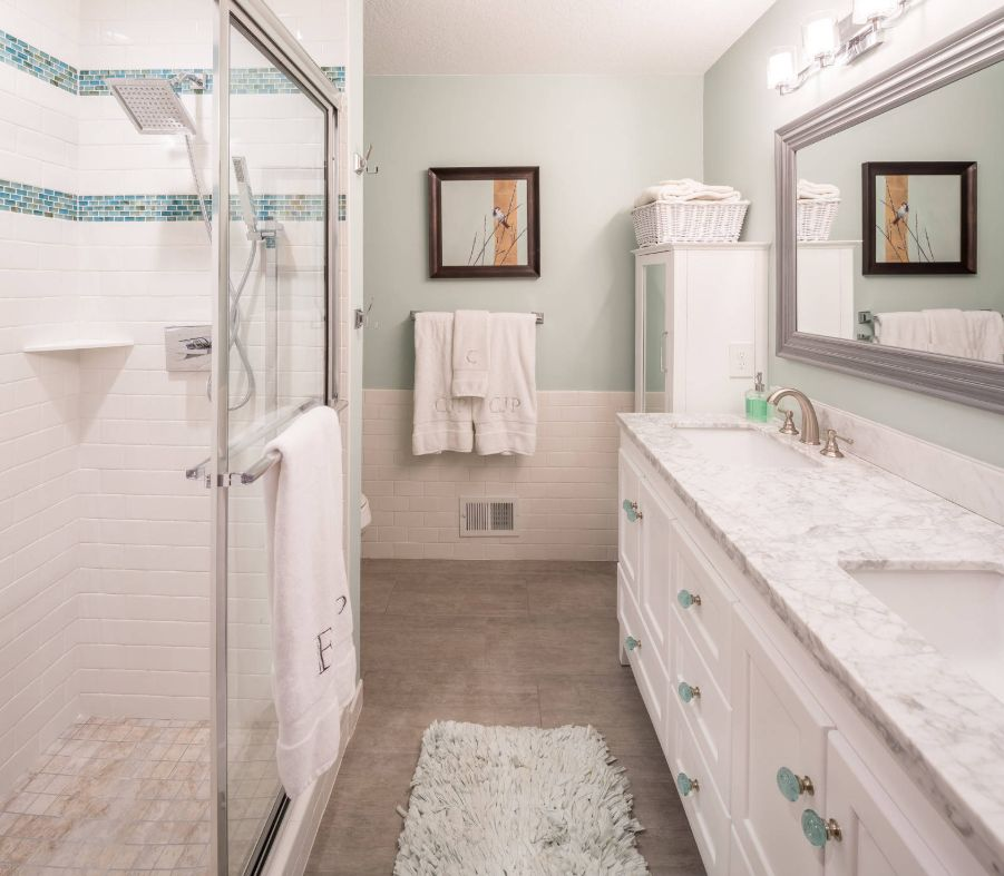 a very neutral and peaceful bathroom is refreshed with turquoise and aqua accents for a chic and calming feel