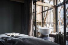 a moody bedroom with a bathtub