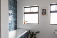 bathroom clad in cool tiles