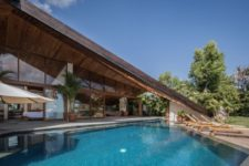 05 There's a small pool of a geometric shape, with a row of loungers and a gorgeous sea view