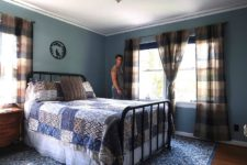 05 This is a blue guest bedroom with a forged bed, plaid curtains, blue textiles and vintage furniture
