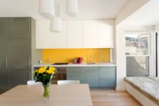 05 a neutral open space made bolder and brighter with a yellow backsplash, green and grey cabinets