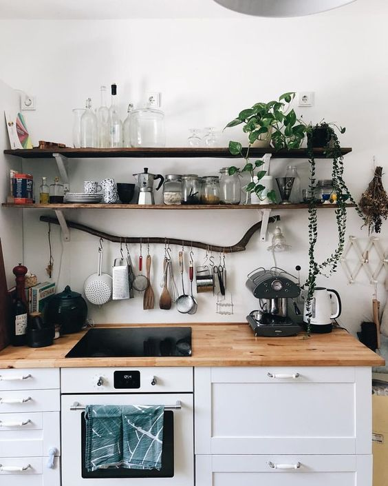 thin dark shelves of reclaimed wood is a nice natural touch to your kitchen and a branch adds even more