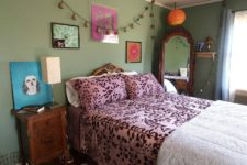 06 Here's amother bedroom done in green, with elegant and refired carved furniture and bright textiles and art