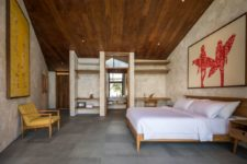 06 The bedroom is done in neutrals, a rich-colored wood ceiling, modenr furniure and open storage space