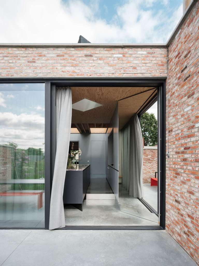 The extension is partly glazed but the glazed walls can be covered with curtains